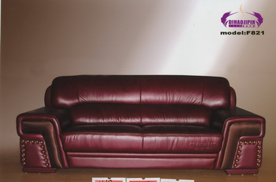 Vintage dark red leather sofa