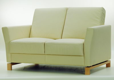 Beige soft and snug love seat