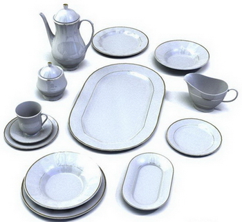 A set of white porcelain dinnerware