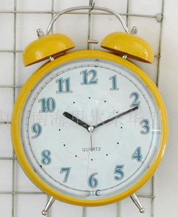 Yellow cartoon small alarm clock