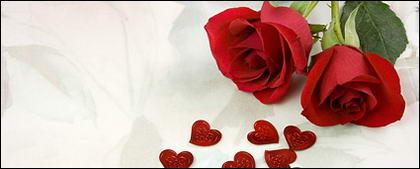 2 つの赤いバラとハートの画像
